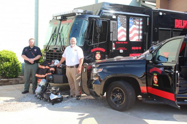 Delhi Fire Chief Ken Hall, right, and Deputy Chief Micah Duchesne display some of the new equipment recently funded by two AFG grants.